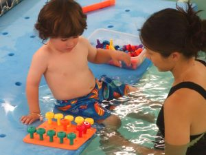 lisa-with-boy-in-pool at Bergen Pediatric Therapy